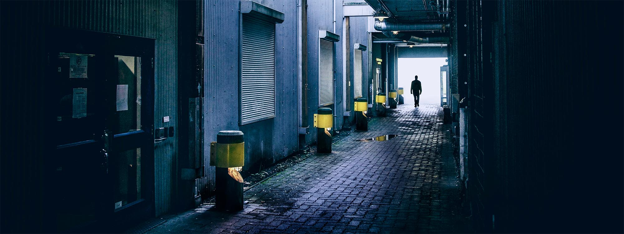 Man walking down alley
